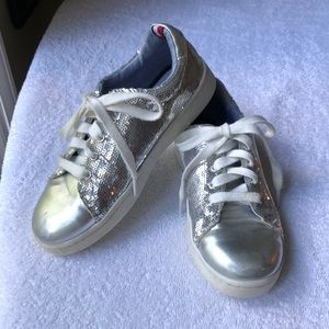 Girls Tommy Hilfiger Silver sequined sneakers.
